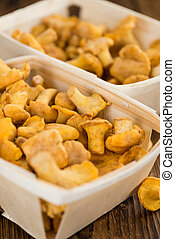 Portion of Chanterelles on wooden background, selective...