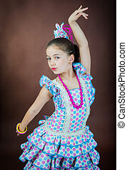 cute little girl is dancing on a dark background - A sweet...