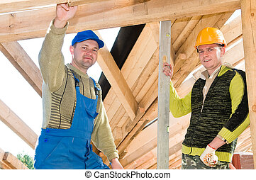 group of roofers - group of carpenters roofers workers in...