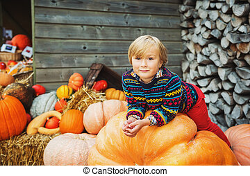 Adorable little boy of 5-6 year old choosing halloween...