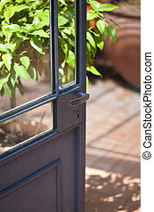 Open door in a classic French green house