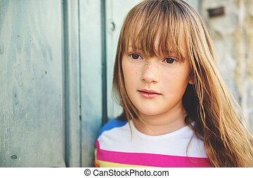 Close up portrait of a cute little girl of 9-10 year old