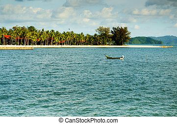 Fishing boat alone in the bay with blue water and forest -...