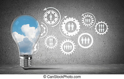 Blue skyscape and clouds inside lightbulb. - Lightbulb with...