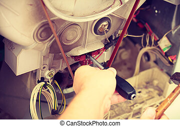 Mechanic repairing washing machine.