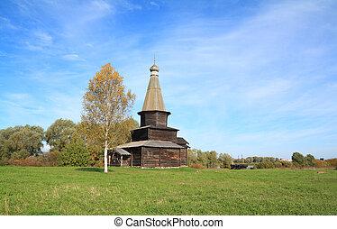 wooden chapel on green field
