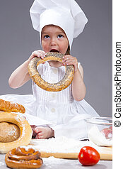 Food Concepts and Ideas. Little Caucasian Girl In Cook...