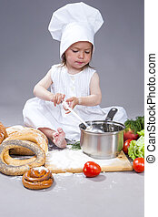 Caucasian Girl In Cook Uniform Preparing a Soup and Making a...