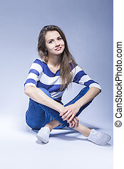 Trendy and Fashionable Positive Caucasian Brunette Girl...