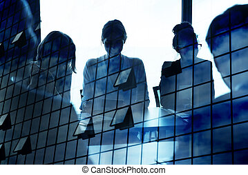Silhouette of businessperson in office with skyscraper...