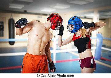 Two person training kikboxing on ring - Couple workout on...