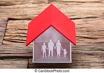 Paper Family In House Model On Table