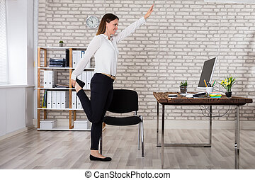Female Manager Stretching Her Arms