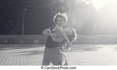Young couple dancing on the square - Slow motion. Young...