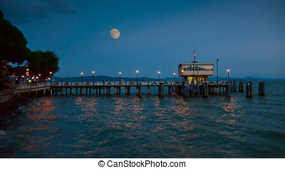 Pier at Passignano, Umbria in moonlight - Pier in...