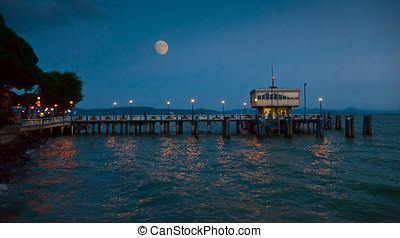 Pier at Passignano, Umbria in moonlight - Pier in...