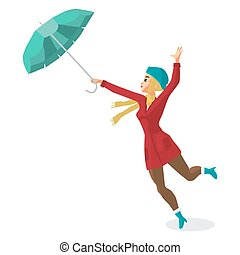 Young woman holding her umbrella in the wind. Girl in the...