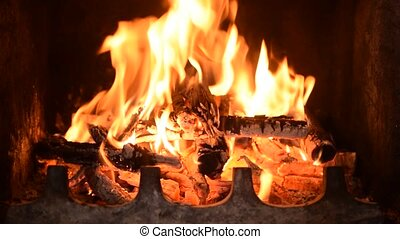 Hot fireplace full of burning wood and fire