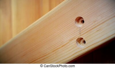 Driving a screw into wooden plank - Craftsman drives a screw...