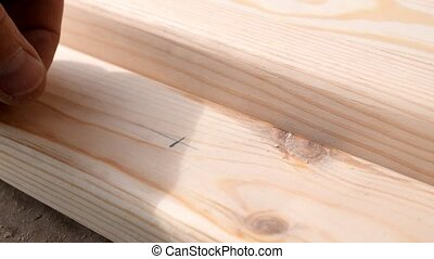 Drilling a wooden plank with a drill - Drilling a pine wood...