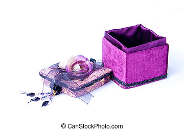 Open purple gift box with a rose isolated.