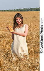 Girl in the field hold a bread - Pretty Girl in the field...