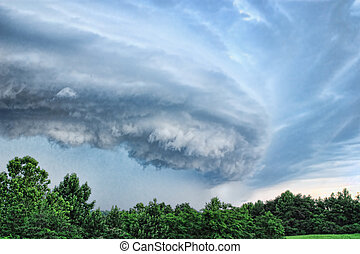 Wall Cloud - Dangerous wall cloud forming a tornado in...