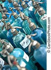 Old bottles of seltz water in a flea market