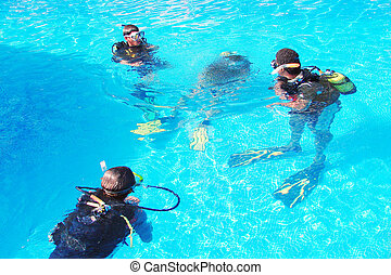 Divers in a pool - Diving class in a pool...
