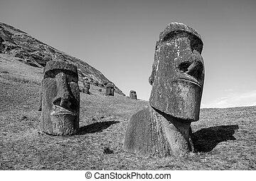 Moais statues on Rano Raraku volcano, easter island. Black...