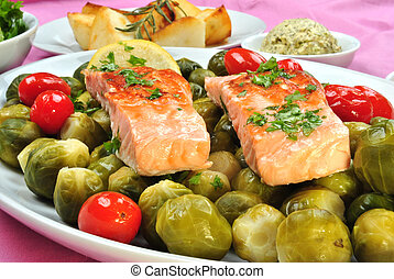 grilled salmon with organic brussel sprout on a plate
