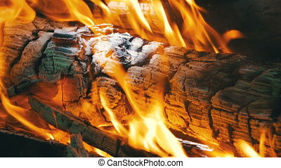 Background of a Fire, a Log Burns. Burning logs in orange...