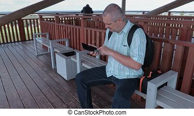 Tourist using tablet on view tower