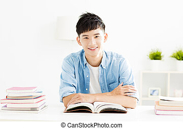Young man studying in living room