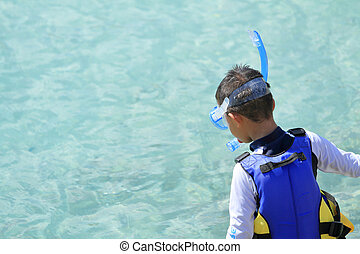 Japanese boy swimming with snorkel (second grade at...