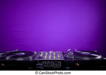dj equipment on violet background