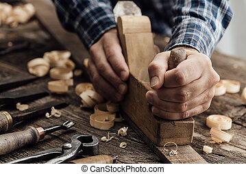 Carpenter working in his workshop
