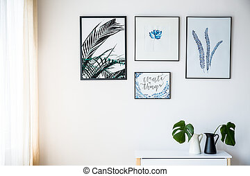 Pictures with plants motif on the white wall