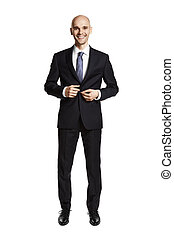 Businesswear - Studio shot of young smiling man getting...