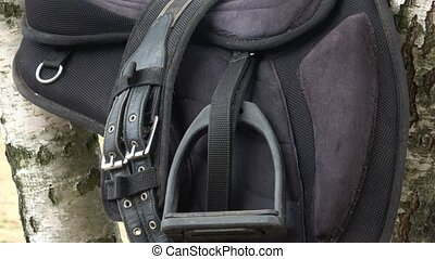 Detail of a horse saddle. Saddle with stirrups.