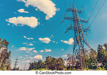 High-voltage power line in the field. Toned image.