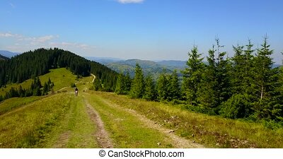 Motorcycle rides on a mountain road, Eastern Europe. -...
