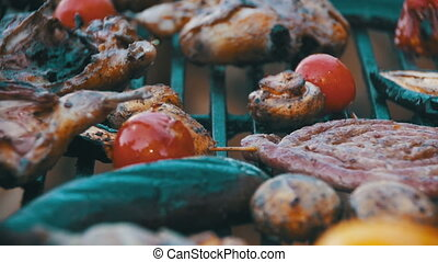 Cooking Barbecue Delicious Sausages, Meat and Vegetables on...