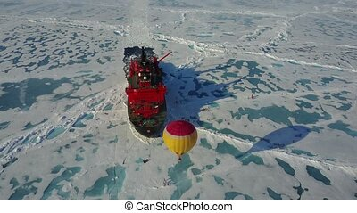 Hot air balloon flying above ice - Hot air balloon flying...
