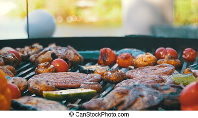 Cooking of Sausages and Vegetables on the Grill - Cooking of...