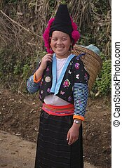 Red pompons Hmong girl - Headdress typical of young Hmong...
