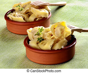 Delicious Meat Cappelletti with Herbs in Ceramic Bowls with...