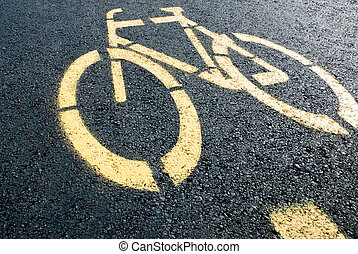 Bicycle lane sign on road - pathway for bicycle with yellow...