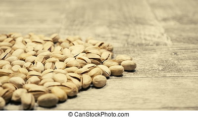 Healthy Pistachios on wooden background in studio. Healthy...