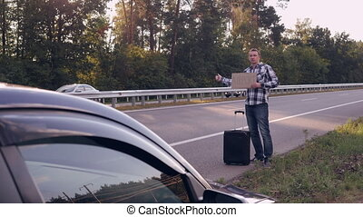 Traveller get town hitch-hiking - Caucasian man standing on...